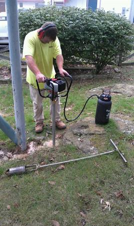 BHATE Engineering drilling in a back yard with the Shaw Portable Core Drill