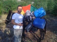 Mr. TOPUZ standing next to a mule he using to pack in additional water and the Shaw Portable Core Drill for remote location drilling in Turkey