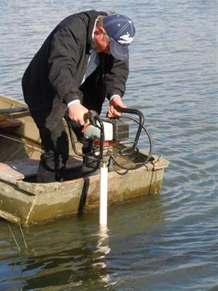 Neil Shaw drilling with the Shaw Portable Core Drill off a boat on a pond located in Yamhill, Oregon